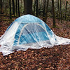 A hard rain's gonna fall.  A drop cloth makes a pretty quick improvised tarp.