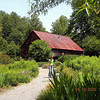 The Lily Barn in Townsend TN with one of the gardeners in the path. <br /> 6/22/09