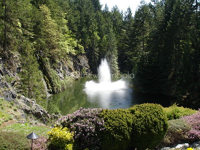 Fountain in old quarry pit Butchart gardens Victoria BC Canada.