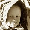 Nikki in her Little House on the Prairie hat her Auntie Marvel bought for her in S. Dakota.