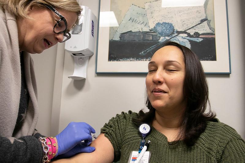 RN Elizabeth Curran gives LPN Luzlin Ortiz a flu shot at UMass Memorial HealthAlliance-Clinton Hospital in Leominster. SENTINEL & ENTERPRISE/JOHN LOVE