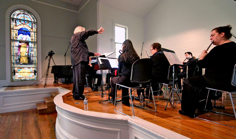 Flutists for the Harmonie Transverse group warm up for a concert at the Parish Center for the Arts in Westford, directing on left is Jay V. Kast-Tuttle. SUN/David H. Brow