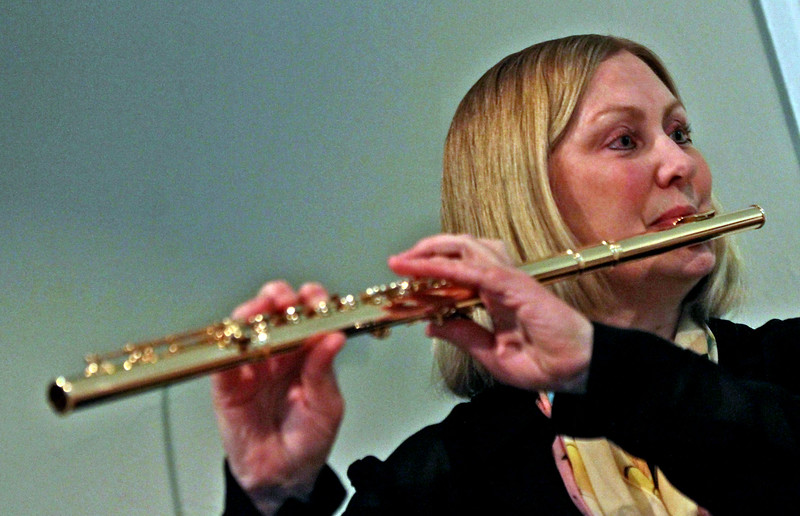 Local flutist from the group Harmonie Transverse, Elise Locker,of Westford, warms up for a concert at the Parish Center for the Arts in Westford. SUN/David H. Brow