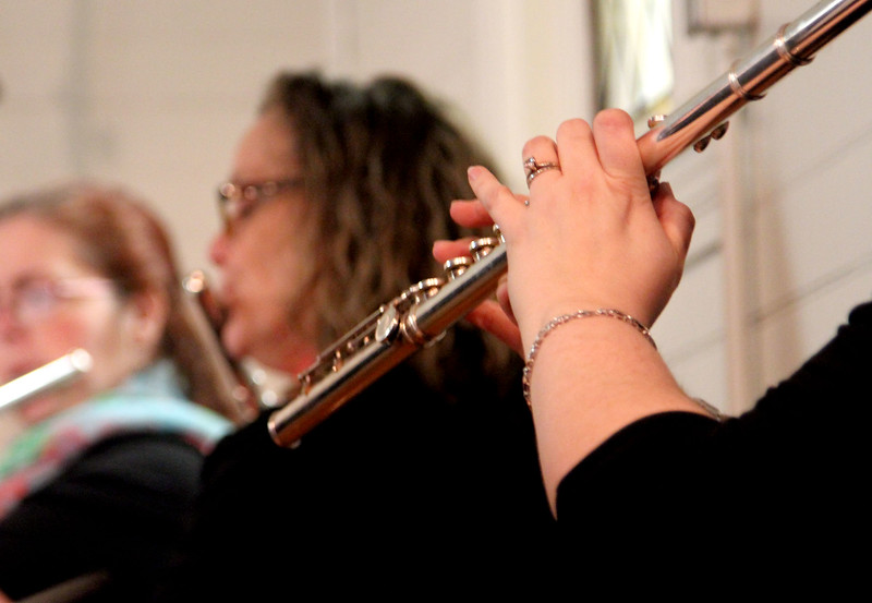 Flutists warming up for a concert at the Parish Center for the Arts in Westford. SUN/David H. Brow