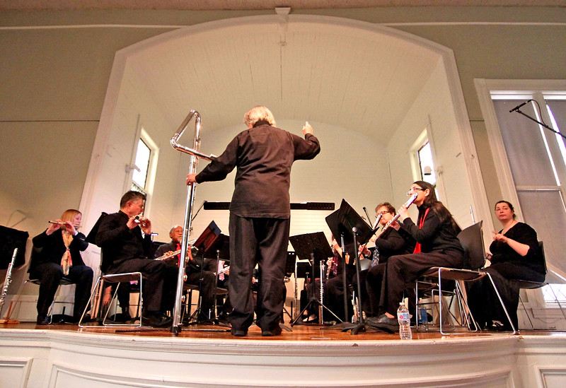 Flutists from the group, Harmonie Transverse, warm up for a concert at the Parish Center for the Arts in Westford. SUN/David H. Brow