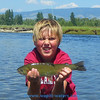 Here is the trout! Nice job, Jamie. He knows how to hold a fish.