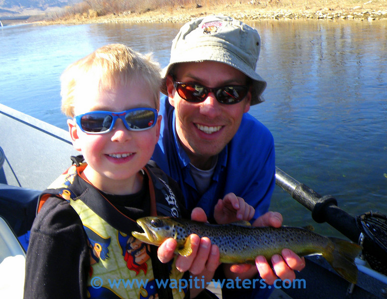 Jack's son-in-law, Marshall, with his son, Tristen. Jack is rowing the boat. This is on the Big Horn river.
