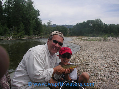 Craig and his son. Learning to love fishing!