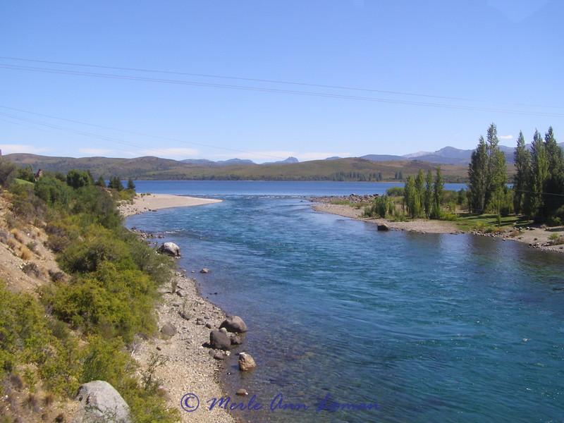 river flowing into a lake near Bariloche