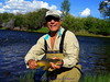 Joe with a beautiful brown trout - August