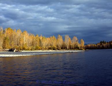Gloomy fall sky over the river