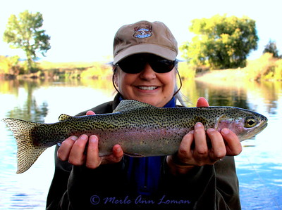 The author with a nice rainbow trout. Photo taken by Jack Mauer with Merle's camera.