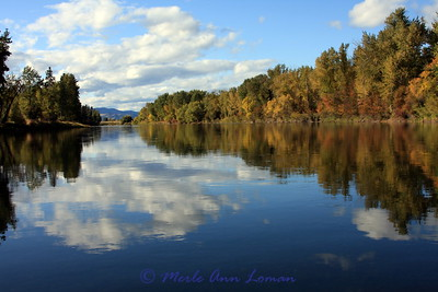 Glassy river with reflections