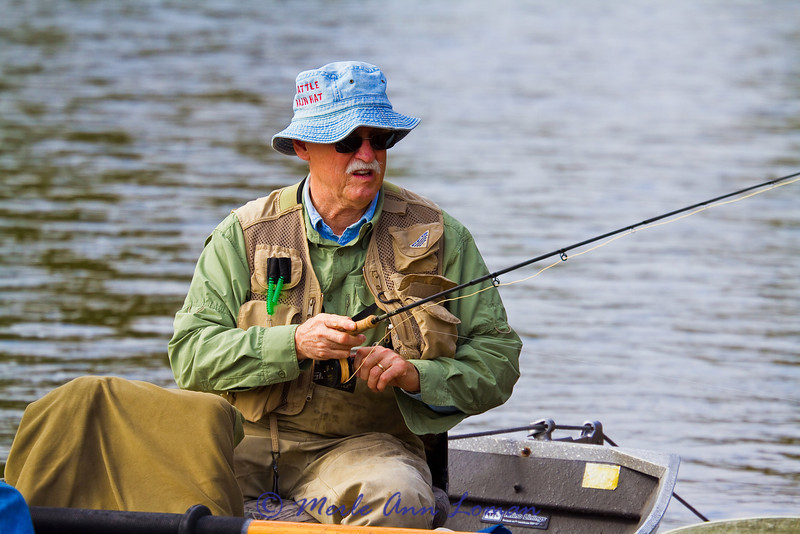 Jim is loading his fly line onto his reel.