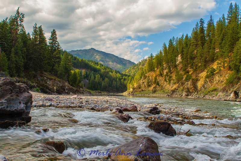 This is where the creek enters the Clark Fork. To the left is lots of water in the river. I am standing on the shore of the creek as I take this photo. Looking west (down-river).