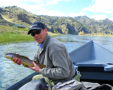 Marshall with a trout that Jack caught on the Missouri River