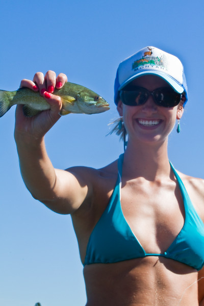 Sadie with a smallmouth bass.