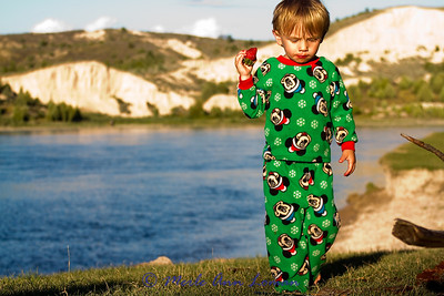 Carter in his jammies having a strawberry for a snack. Got to love this kind of life...