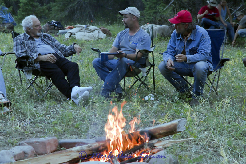 Conversation by the fire after a long day in the saddle.