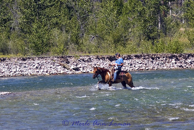Heading across the river from camp, crossing in a shallower place
