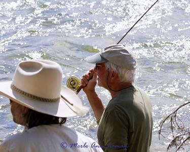 wade fishing near camp