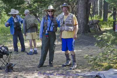 Getting ready to go wade fishing, sporting unique outfits.