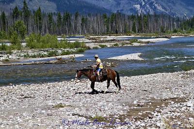 The start of heading across the river on horses.