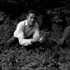 USA. Stony Point, NY. 1965. John CAGE picking herbs for lunch at his upstate-New York home.