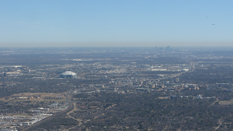 Cowboy Stadium and Dallas skyline in distance.  Arrivals into DFW on final.