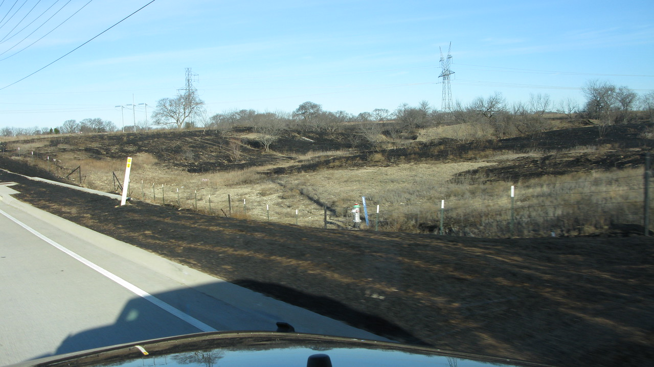 Grass fire scars on the way to the airport 1/23/18.  Fire yesterday.