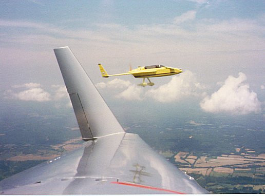 "Cheryl took this pic from the back sit. On our way from Leesburg, FL, to Kansas City.<br /> Jack Fahling on our left is flying the in his VariEze""Yellow Bird."""