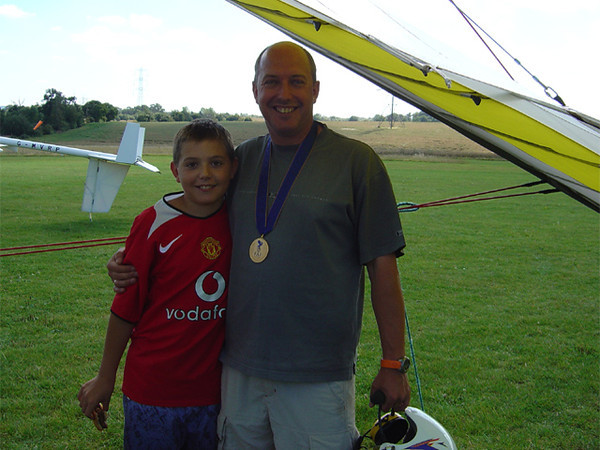 Chris with his son and the Gold Medal