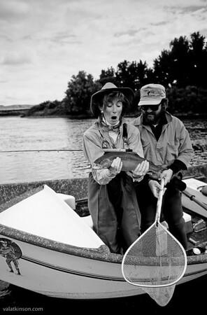 susan rockrise after landing the biggest trout of her life,  big hole river