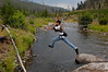 David taking a leap of faith over Tower Creek, Yellowstone National Park
