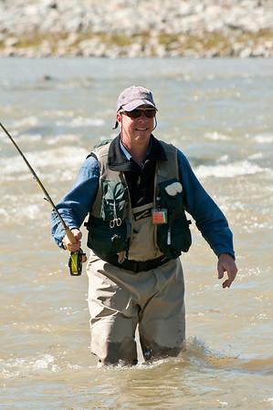 John wading the Yuba, spring runoff