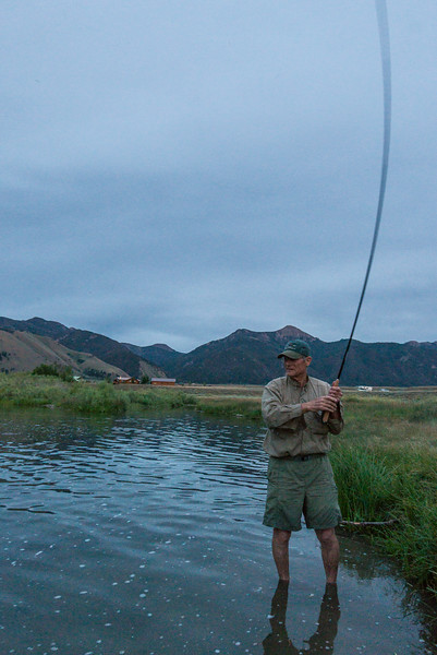 Scott Kellermann fighting a large brown trout with a Tenkara rod on the Madison