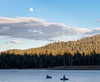 Fly Fisherman Fishing the Hex Hatch under a Big Moon, Lake Almanor CA