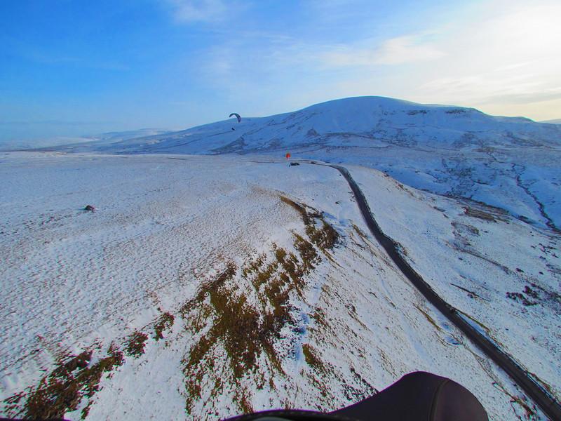 A snowy ridge towards take off