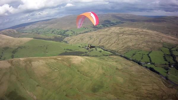 Pete Southern on Cautley  flying Ozone Swift.  Lower take off knolls below.