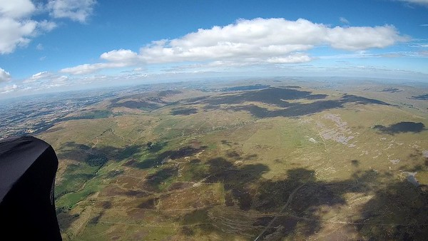 A poor start to the day on Great Coum (too windy, then too light and wind went off to north).  Eventually (after several attempts) got a climb out from the small N face steps. Day now looking superb - low save on moor below to nearly 6000'.