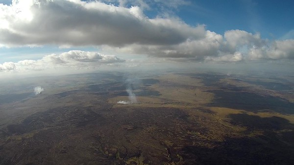 The vast moors behind Great Whernside. Note the  smoke,  horizontal at ground level, then pulled vertically by the thermal.