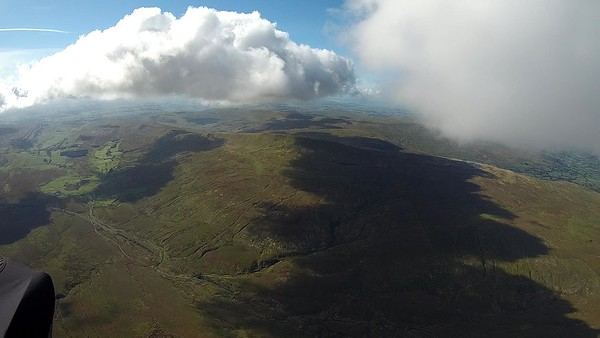 First climb out and away under the big  cloud. The street can be seen extending west to the Lune valley.