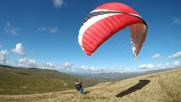 Chris launches stylishly into a lovely breeze - perfect. Howgills in the middle distance.