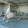 The plane  back resting in the hangar