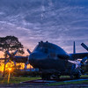"The sun setting behind the retired AC-130H Spectre Gunship known as ""Wicked Wanda"" at Hurlburt Field in Florida."