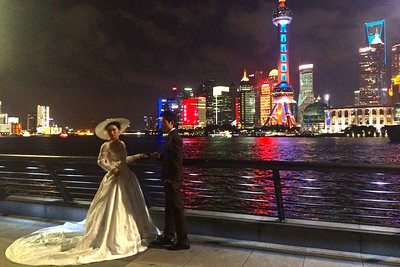 Couples posing against the skyline