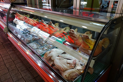 Pigs' heads at a butcher
