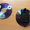 Camera mount for Muvi HD 10. Two CD's with three penny washers matching three neodyth magnets with 3.1kg pull each.