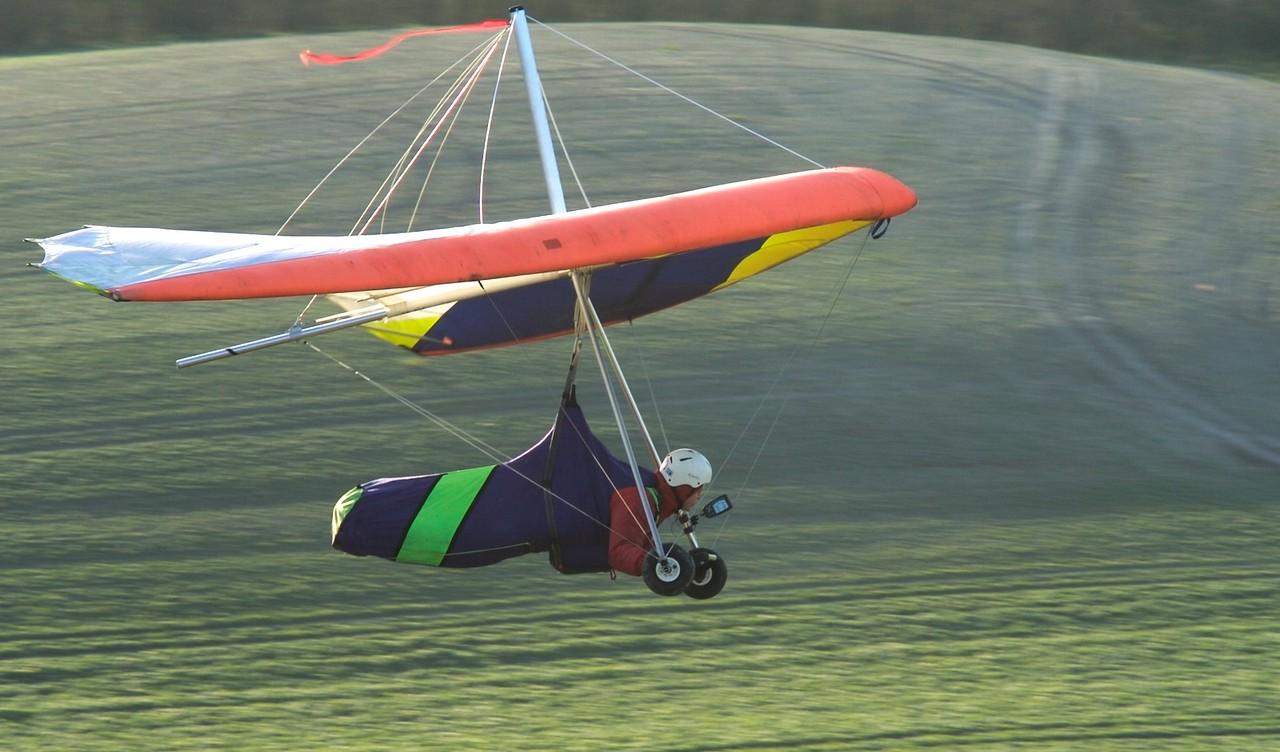 Learner Hang Glider Pilot Landing