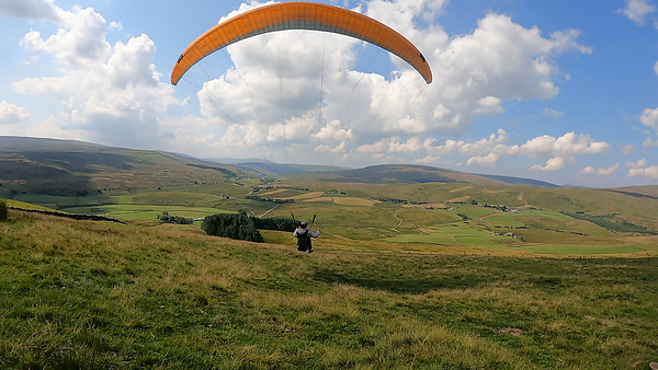 Chris taking off on Cotterside. Only a light breez - but it's one awesome thermal place - or it was given the day's instability.